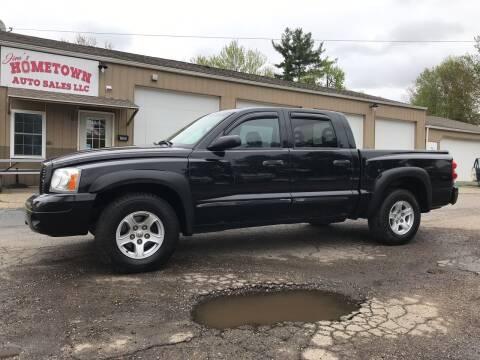2006 Dodge Dakota for sale at Jim's Hometown Auto Sales LLC in Byesville OH