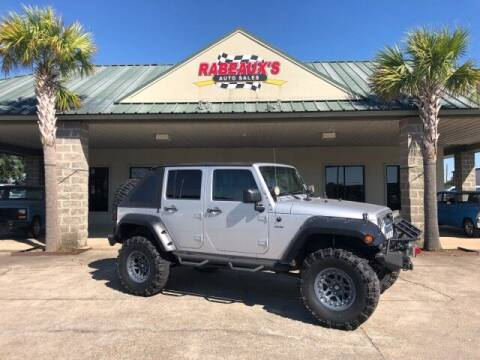 2011 Jeep Wrangler Unlimited for sale at Rabeaux's Auto Sales in Lafayette LA