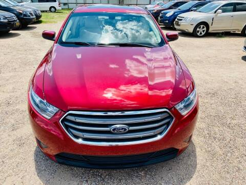 2014 Ford Taurus for sale at Good Auto Company LLC in Lubbock TX