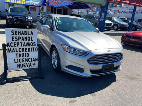 2013 Ford Fusion for sale at Cedano Auto Mall Inc in Bronx NY