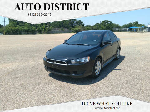 2015 Mitsubishi Lancer for sale at Auto District in Baytown TX
