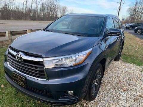 2016 Toyota Highlander for sale at Lighthouse Auto Sales in Holland MI
