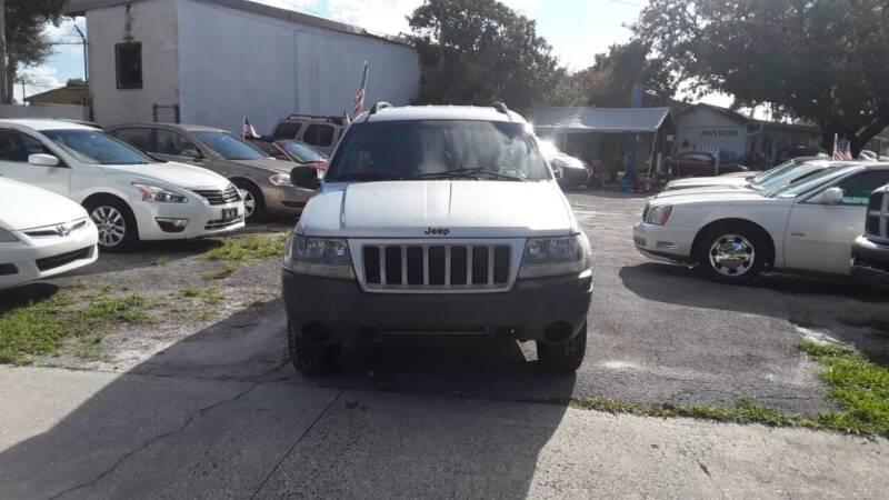 2004 Jeep Grand Cherokee for sale at DAVINA AUTO SALES in Orlando FL