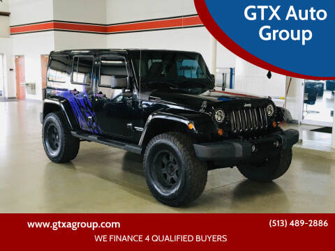 2011 Jeep Wrangler Unlimited for sale at GTX Auto Group in West Chester OH