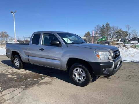 2014 Toyota Tacoma for sale at BERKENKOTTER MOTORS in Brighton CO