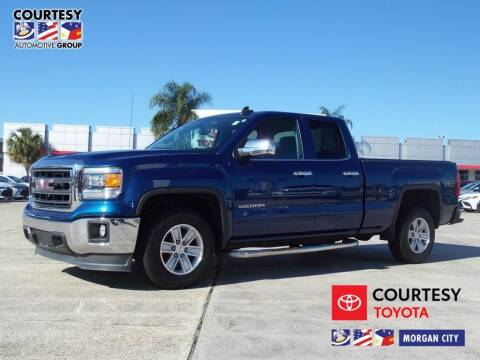2015 GMC Sierra 1500 for sale at Courtesy Toyota & Ford in Morgan City LA