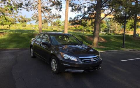 2011 Honda Accord for sale at QUEST MOTORS in Englewood CO