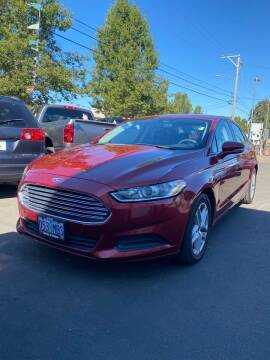 2013 Ford Fusion for sale at M AND S CAR SALES LLC in Independence OR
