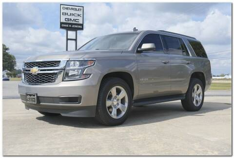 2018 Chevrolet Tahoe for sale at STRICKLAND AUTO GROUP INC in Ahoskie NC