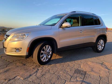 2011 Volkswagen Tiguan for sale at CALIFORNIA AUTO GROUP in San Diego CA
