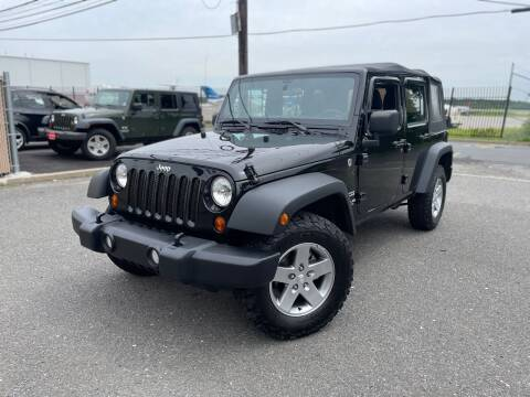 2012 Jeep Wrangler Unlimited for sale at A1 Auto Mall LLC in Hasbrouck Heights NJ