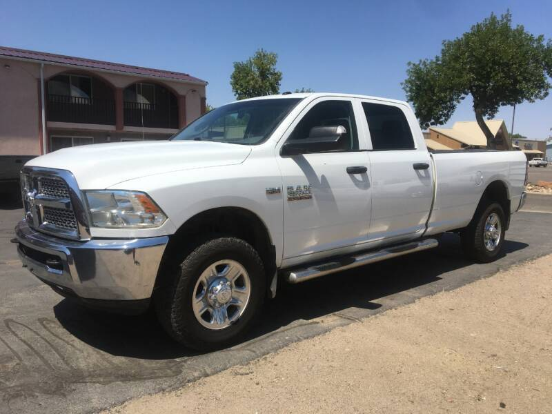2014 RAM Ram Pickup 2500 for sale at KHAN'S AUTO LLC in Worland WY