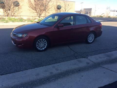 2010 Subaru Impreza for sale at AROUND THE WORLD AUTO SALES in Denver CO
