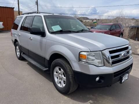 2011 Ford Expedition for sale at BERKENKOTTER MOTORS in Brighton CO