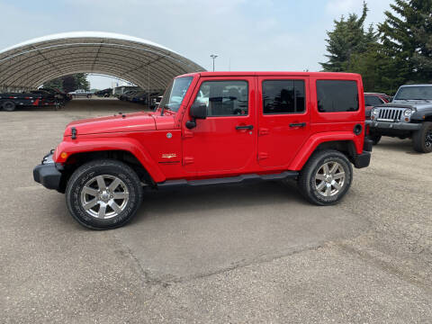 2014 Jeep Wrangler Unlimited for sale at Truck Buyers in Magrath AB