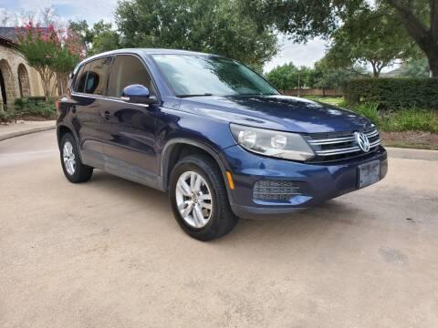 2013 Volkswagen Tiguan for sale at Exhibit Sport Motors in Houston TX