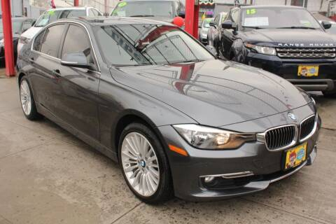 2014 BMW 3 Series for sale at LIBERTY AUTOLAND INC in Jamaica NY