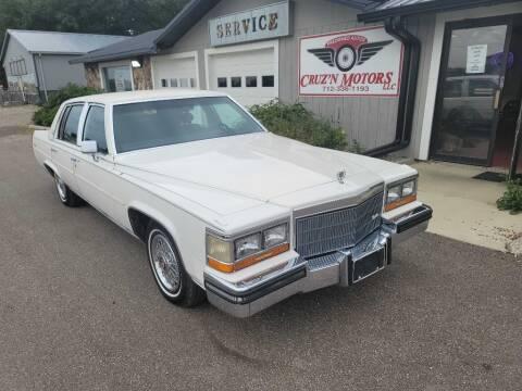 1986 Cadillac Fleetwood Brougham for sale at CRUZ'N MOTORS - Classics in Spirit Lake IA
