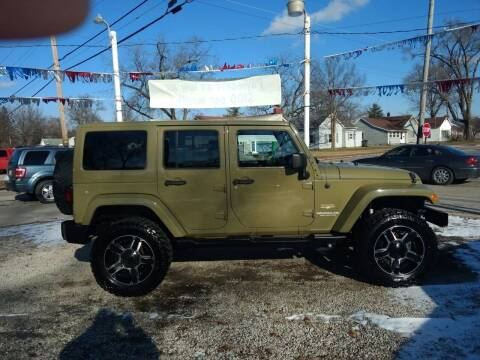 2013 Jeep Wrangler Unlimited for sale at Antique Motors in Plymouth IN