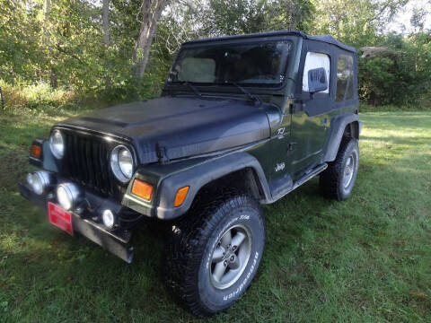 1997 Jeep Wrangler for sale at John's Auto Sales in Council Bluffs IA