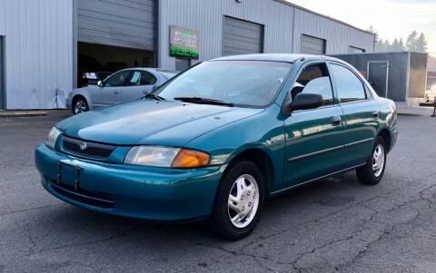 1997 Mazda Protege for sale at DASH AUTO SALES LLC in Salem OR