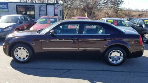 2005 Chrysler 300 for sale at Howe's Auto Sales in Lowell MA