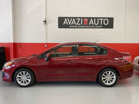 2014 Subaru Impreza for sale at AVAZI AUTO GROUP LLC in Gaithersburg MD