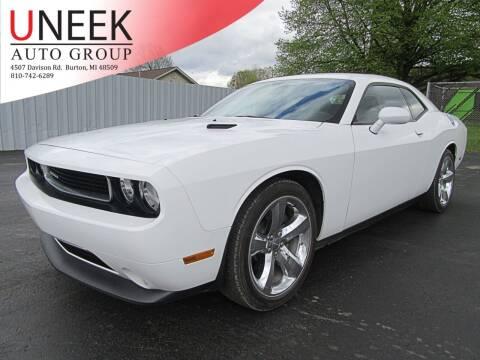 2013 Dodge Challenger for sale at Uneek Auto Group LLC in Burton MI