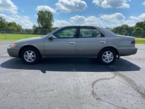 1998 Toyota Camry for sale at Caruzin Motors in Flint MI