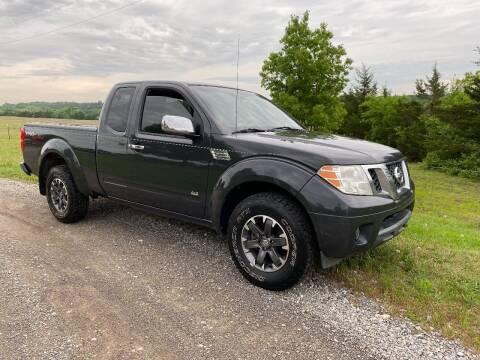 2010 Nissan Frontier for sale at CAVENDER MOTORS in Van Alstyne TX