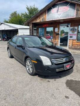 2009 Ford Fusion for sale at LEE AUTO SALES in McAlester OK