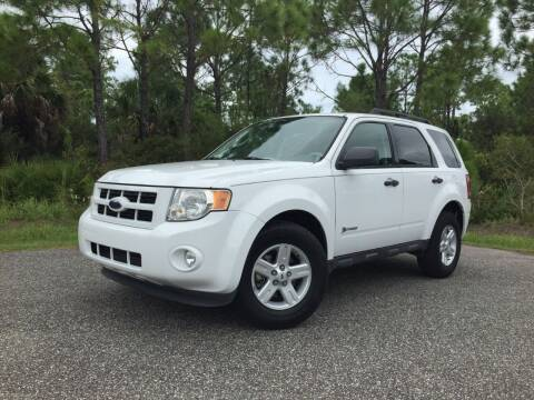 2009 Ford Escape Hybrid for sale at VICTORY LANE AUTO SALES in Port Richey FL