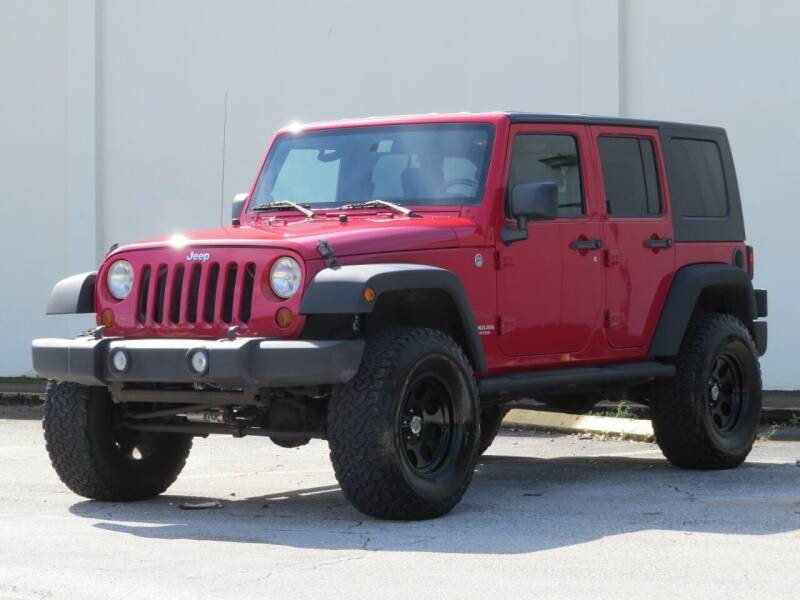 2010 Jeep Wrangler Unlimited for sale at DK Auto Sales in Hollywood FL