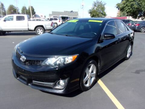 2014 Toyota Camry for sale at Ideal Auto Sales, Inc. in Waukesha WI