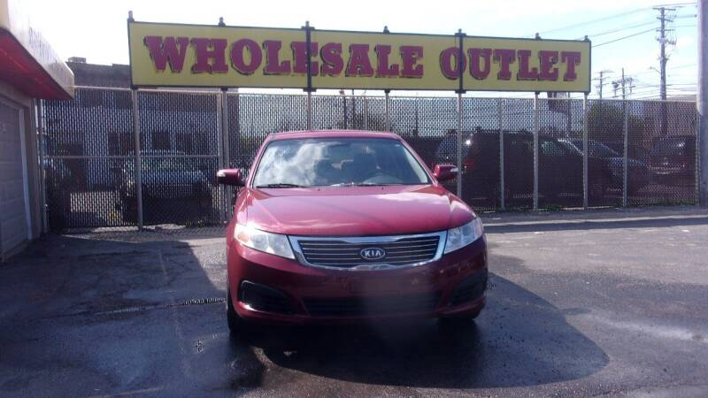 2009 Kia Optima for sale at LONG BROTHERS CAR COMPANY in Cleveland OH