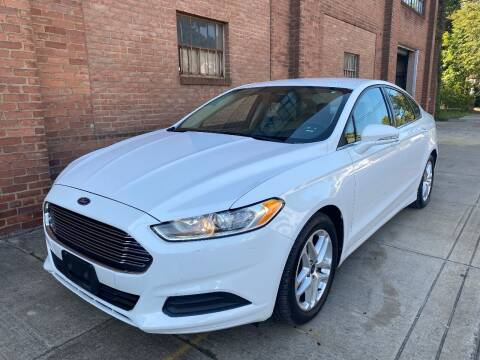 2014 Ford Fusion for sale at Domestic Travels Auto Sales in Cleveland OH