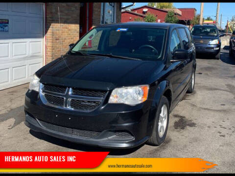 2011 Dodge Grand Caravan for sale at HERMANOS AUTO SALES INC in Hamilton OH