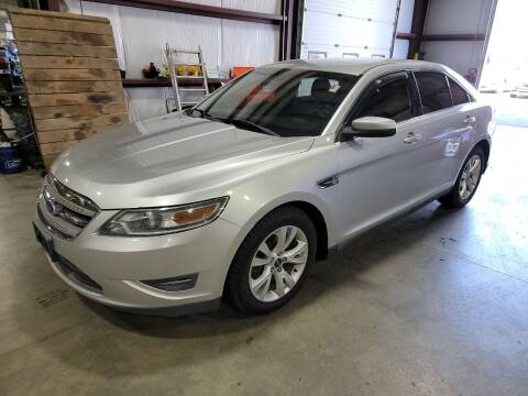 2012 Ford Taurus for sale at Hometown Automotive Service & Sales in Holliston MA