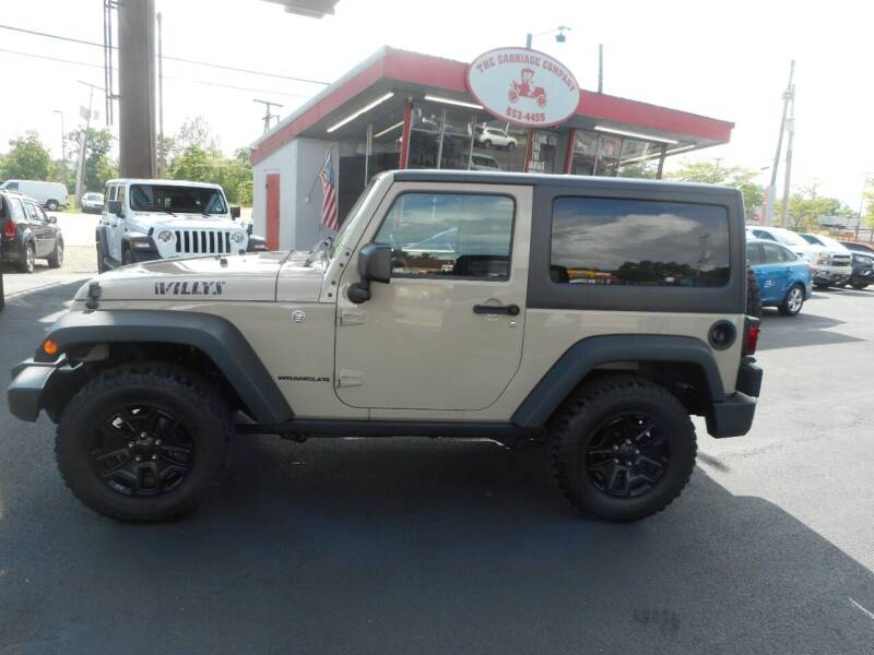 2016 Jeep Wrangler for sale at The Carriage Company in Lancaster OH
