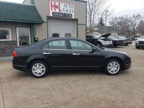 2011 Ford Fusion for sale at H & L AUTO SALES LLC in Wyoming MI