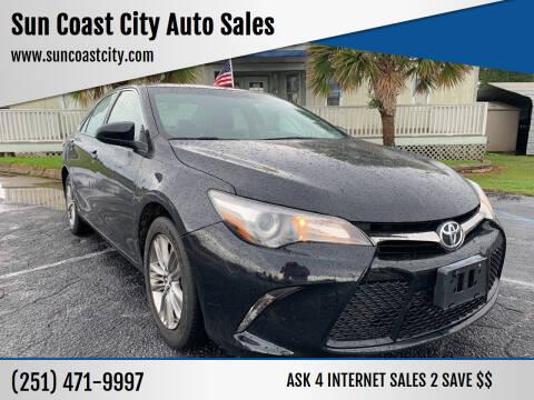 2015 Toyota Camry for sale at Sun Coast City Auto Sales in Mobile AL