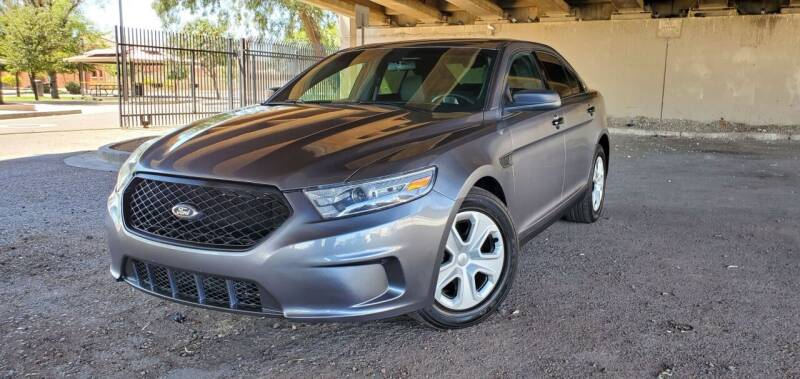 2014 Ford Taurus for sale at MT Motor Group LLC in Phoenix AZ
