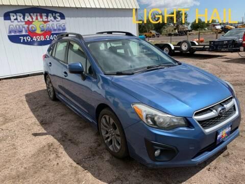 2014 Subaru Impreza for sale at Praylea's Auto Sales in Peyton CO