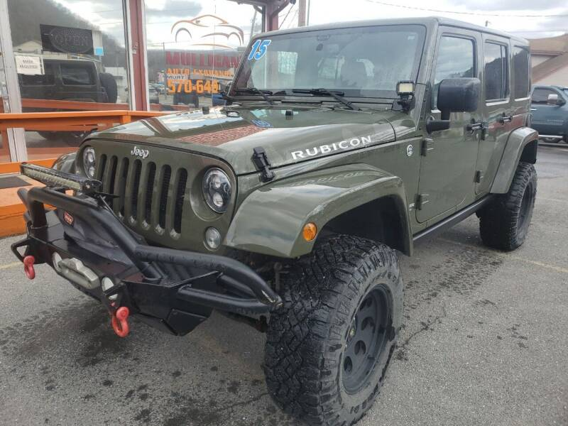 2015 Jeep Wrangler Unlimited for sale at Mulligan's Auto Exchange LLC in Paxinos PA