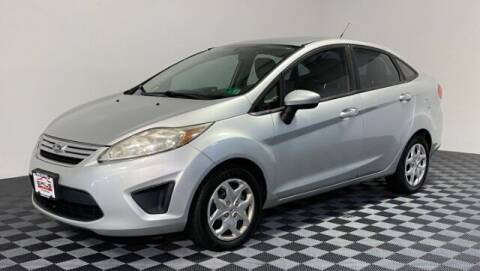 2012 Ford Fiesta for sale at SIRIUS MOTORS INC in Monroe OH