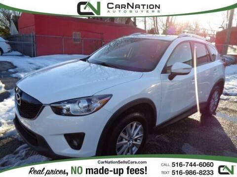2015 Mazda CX-5 for sale at CarNation AUTOBUYERS Inc. in Rockville Centre NY