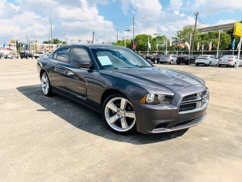 2014 Dodge Charger for sale at Sam's Auto Sales in Houston TX