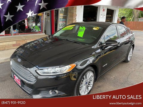 2014 Ford Fusion Hybrid for sale at Liberty Auto Sales in Elgin IL