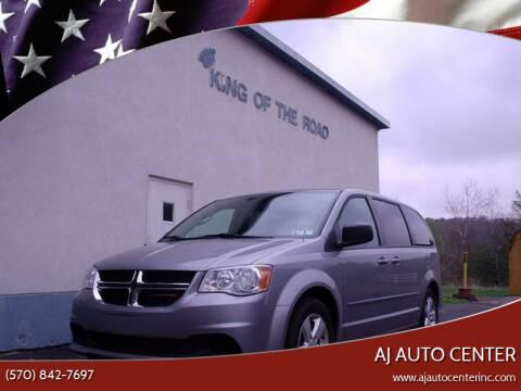 2013 Dodge Grand Caravan for sale at AJ AUTO CENTER in Covington PA