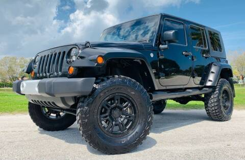 2008 Jeep Wrangler Unlimited for sale at PennSpeed in New Smyrna Beach FL